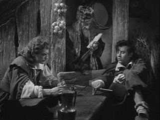 The dealings of Belle's suitor Avenant (also Jean Marais) and brother Ludovic (Michel Auclair) bring her family into financial troubles.