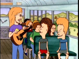 Hippie teacher Mr. Van Driessen hopes Beavis and Butt-head will be better behaved in the front of the school bus.