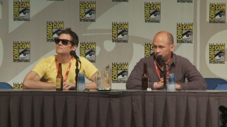 A shaded Johnny Knoxville moderates, while creator Mike Judge answers questions at Beavis and Butt-Head's 2011 San Diego Comic-Con Panel.