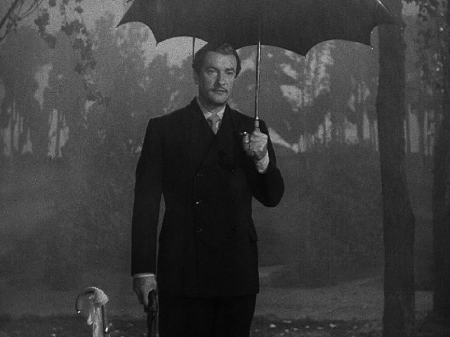"Georges Duroy (George Sanders) is a scoundrel in the rain in the duel climax invented for ""The Private Affairs of Bel Ami."""