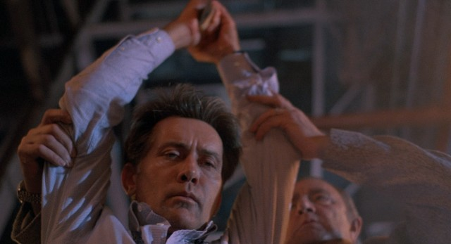 "Cal Jamison (Martin Sheen) is coerced into taking grave action in the chilling climax of ""The Believers."""