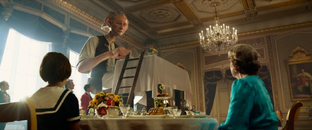 In a seemingly random turn, the BFG (Mark Rylance) drops by Buckingham Palace and gets to dine with the Queen.