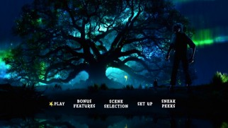 The BFG and Sophie hang around the dream forest in the tasteful, subtly animated main menu.