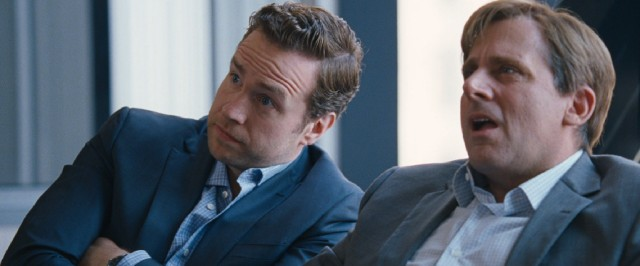 Danny Moses (Rafe Spall) and Mark Baum (Steve Carell) have different facial reactions to Jared Vennett's Jenga pitch.