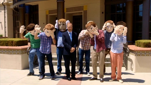 Chairman and CFO Alex Winchells (Bob Odenkirk) is joined by The Birthday Boys, who are quiet in costume heads.