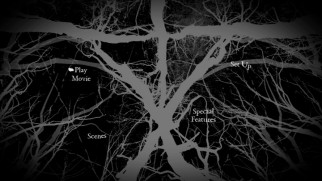 The black and gray main menu animates the branches from the poster/cover art.