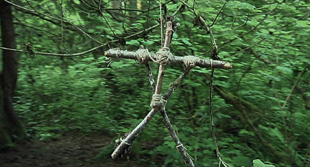 A stick figure hanging from the trees can only mean one thing: the Blair Witch is back!