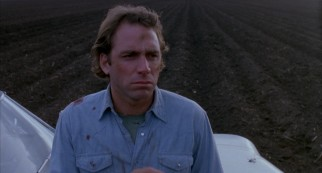 Sitting on his car hood in Texas farmland, a bloodied Ray (John Getz) wonders if he's done the right thing.