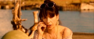 Ginger (Sally Hawkins) gets troubling news over the phone that muddles her relationship status.