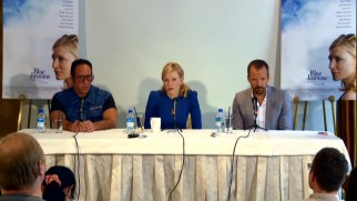 "Two ""Blue Jasmine"" posters overlook the Q & A panel of Andrew Dice Clay, Cate Blanchett, and Peter Sarsgaard."