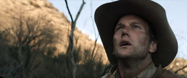 Injured but determined, Arthur O'Dwyer (Patrick Wilson) ambles on in an effort to rescue his wife.