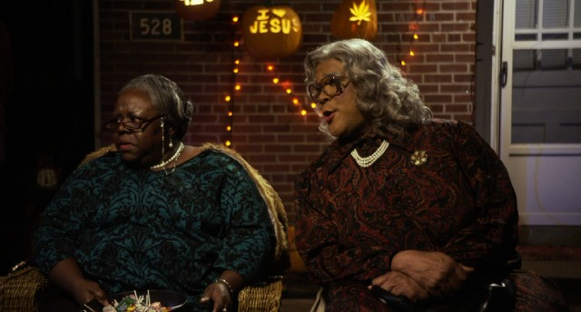 "Madea (Tyler Perry) doesn't believe in giving out candy, but she sits next to Aunt Bam (Cassi Davis) while she does in ""Boo! A Madea Halloween."""