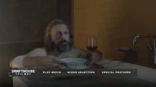 Borgman (Jan Bivjoet) enjoys a bath, a meal, and some television on the Blu-ray's top menu.