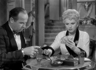 Billie Dawn (Judy Holliday) seems incapable of doing much more than playing gin rummy with her wealthy husband-to-be, Harry Brock (Broderick Crawford).