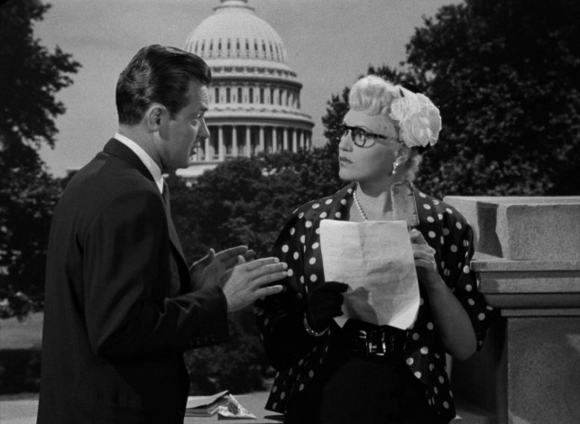 "In ""Born Yesterday"", Paul Verrall (William Holden) schools Billie Dawn (Judy Holliday) on government outside the United States Capitol."