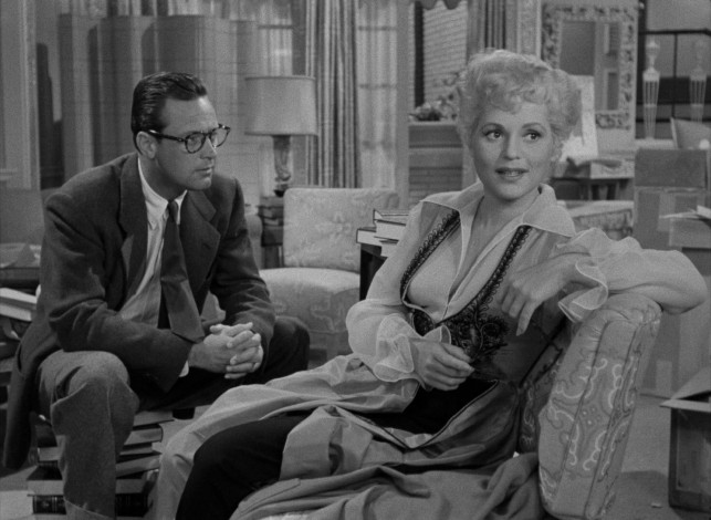 "The bespectacled Paul Verrall (William Holden) sets out to make Billie Dawn (Judy Holliday) less stupid in George Cukor's 1950 comedy-drama ""Born Yesterday."""