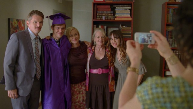 The Evans family unbreaks for a photo with high school graduate Mason Jr. (Ellar Coltrane).