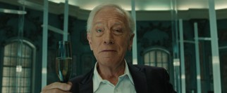 Marketing guru and fast food industry maker-over Joseph Pascal (Max von Sydow) gives a toast to a job well done.