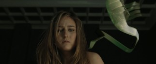 Abby (Leelee Sobieski) finds she has to compete with the hallucinogenic fish-like creature on her back for Misha's attention.