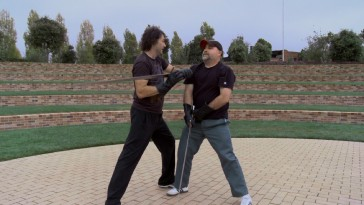 "Director Mark Andrews and story supervisor Brian Larsen have a swordfight to help them visualize the ""Brawl in the Hall."""