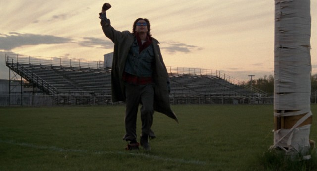 John Bender (Judd Nelson) throws up a fist as he walks across the football field in the film's memorable closing shot.