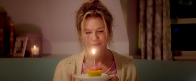 "Bridget Jones (Renée Zellweger) is all by herself (again) celebrating her 43rd birthday with a cupcake in ""Bridget Jones's Baby."""