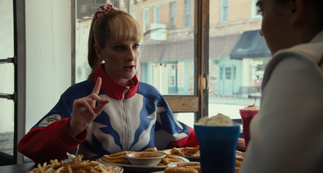 "Hope Ann Greggory (Melissa Rauch) schools her pupil on the importance of fatty fast food in ""The Bronze."""