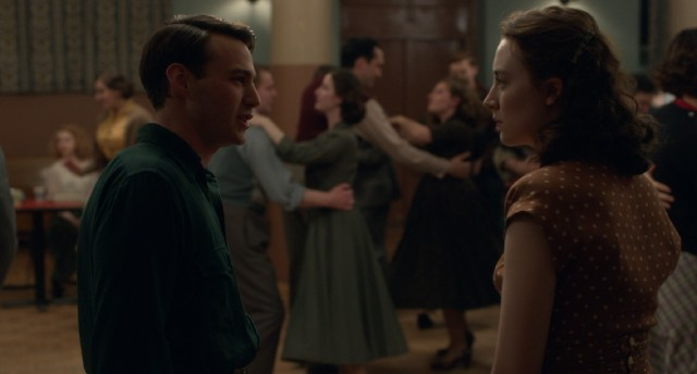 Ellis (Saoirse Ronan) meets Italian-American plumber Tony Fiorello (Emory Cohen) at a lifeless Irish community dance.