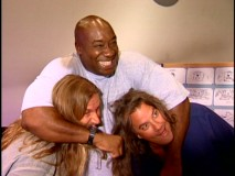 "Michael Clarke Duncan, the voice of Tug who at one time held a lead role, gives a bear hug to long-haired directors Aaron Blaise and Robert Walker in ""Paths of Discovery: The Making of 'Brother Bear.'"""