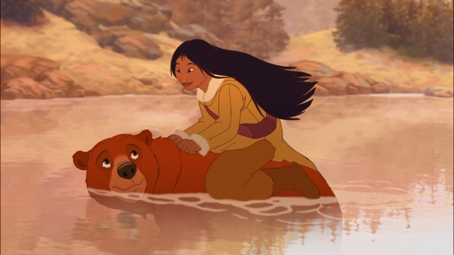"Water-fearing Nita gets a ride from Kenai, her transformed childhood companion, in Disney's ""Brother Bear 2."""