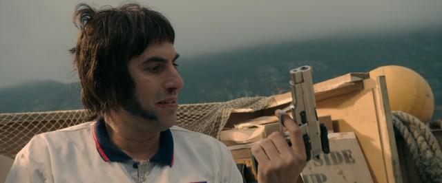 Nobby (Sacha Baron Cohen) quickly develops a fondness for guns, which he uses to dispense anyone and anything in his path.