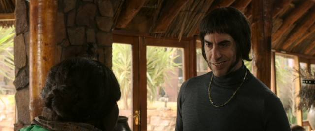 Nobby (Sacha Baron Cohen) attempts a Sean Connery accent as he assumes the spy duties of his incapacitated MI6 agent brother.