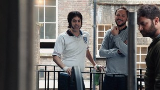 "Sacha Baron Cohen and director Louis Leterrier enjoy a moment on the set of ""The Brothers Grimsby"" in the Blu-ray's making-of featurette."