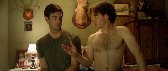 "Shirtless New Yorker cousin Jerry (Jarrod Pistilli) gives Craig (Matthew Albrecht) some unsolicited advice on matters of the heart in ""Buck Wild."""