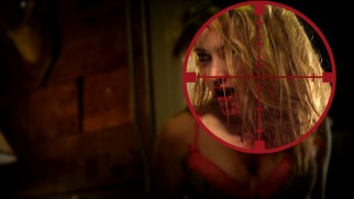 A zombie girl (Meg Cionni) gets in the crosshairs of the Blu-ray's main menu.