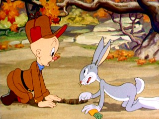 "In his first official appearance, ""A Wild Hare"", Bugs Bunny helps Elmer Fudd during wabbit season."