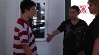 A victim is reluctant to heed the principal's advice, shake hands and forgive his recurring bully.