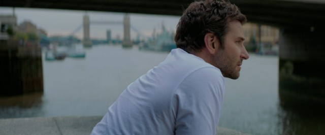 Adam Jones (Bradley Cooper) thinks about his life by the River Thames.