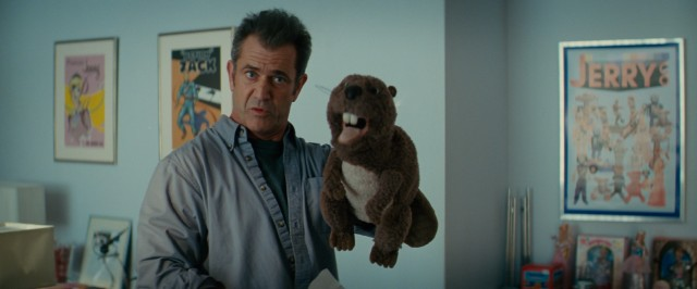 "In ""The Beaver"", Mel Gibson plays a troubled man who finds value in letting a found hand puppet speak for him."