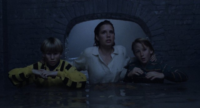 On a night that began with a date and death, Meg Penny (Shawnee Smith) winds up in a sewer with her younger brother (Michael Kenworthy) and his friend (Douglas Emerson), hoping they can stay alive.