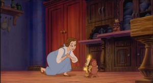 Belle talks with Lumiere the candelabra and Cogsworth the clock, two of the castle's enchanted items.