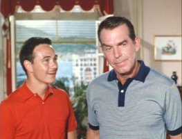 A mustachioed Tommy Kirk with Fred Macmurray