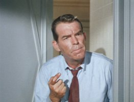 Fred MacMurray got a boo-boo on his finger