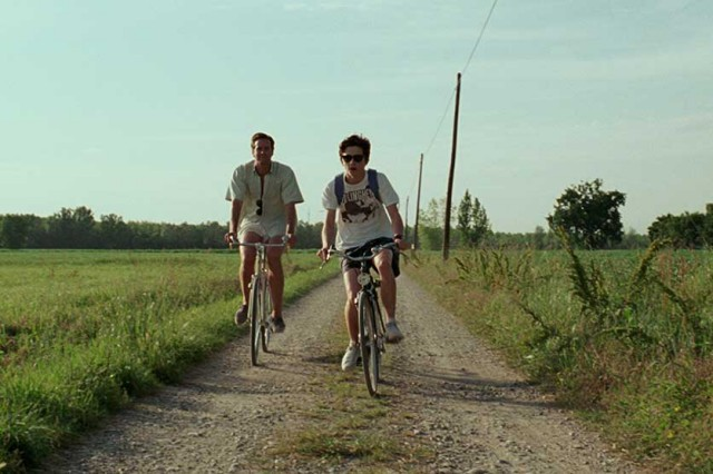 "In ""Call Me By Your Name"", Oliver (Armie Hammer) and Elio (Timothée Chalamet) ride their bikes around the countryside of Northern Italy."
