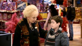 With his mom dead and his dad deployed overseas, Gabe (Quinn Lord) gladly accepts whatever Mrs. Miracle (Doris Roberts) can provide.