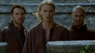 Arthur (Jamie Campbell Bower) is escorted to his realm by non-biological brother Kay (Peter Mooney) and the wizard Merlin (Joseph Fiennes).