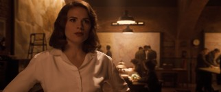 Every superhero needs a super love interest behind them. For Captain America, it's no-nonsense British agent Peggy Carter (Hayley Atwell).