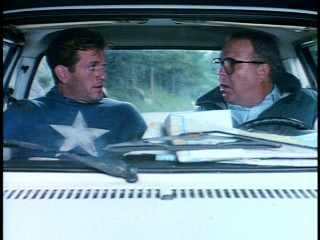 Steve Rogers (Matt Salinger) accepts an opportune ride to safety from Washington journalist Sam Kolawetz, but he can only take so much Ned Beatty.