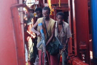 Muse (Barkhad Abdi) leads the Somali pirates aboard the Maersk Alabama.