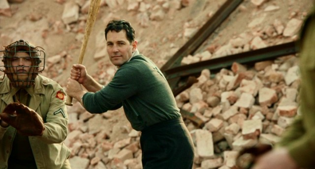 Amidst the chaos of World War II (see the rubble in back), Moe Berg (Paul Rudd) seizes an opportunity to play baseball...because THE CATCHER WAS A SPY!